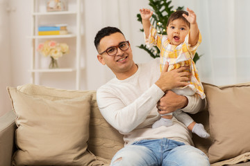 happy father with little baby daughter at home