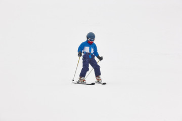 Chidren skiing under the snow. Winter sport. Ski slope