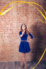 Girl with a ribbon. Brick wall