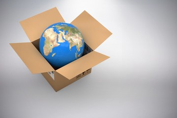 Composite 3d image of vector image of globe in cardboard box