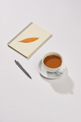 Milk tea in a white mug with paper note.