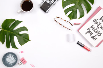Frame made of tropical palm leaf, vintage camera, glasses, coffee cup, lipstick and handwritten quote notebook on white background. Flat lay, top view woman blog mockup. summer travel concept.