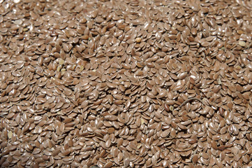 Horizontal shot from above of a large pile of brown flax seeds at the market, also known as souks, in Marrakesh, Morocco