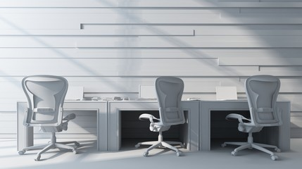 Three chairs standing by workstation