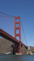 Vertical section of the suspension and view of the northern tower of the iconic Golden Gate Bridge, San Francisco, California, USA