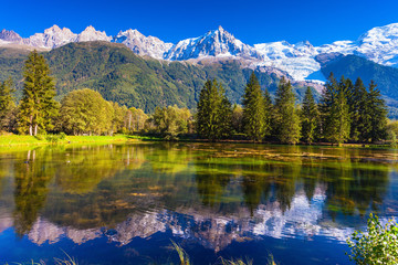 Foto auf Leinwand Reflexion The lake reflected snow-capped Alps