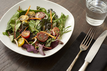fresh salad on brown table
