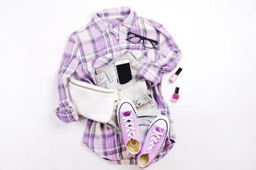 Modern fashionable look for stylish fashion blog lookbook. Flat lay of stylish clothing for woman magazine. Seasonal clearance, Stylish set of woman clothing.