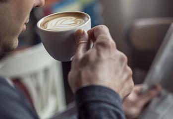 Drinking espresso