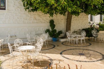 Sunny view of summer cafe at the port of Bodrum, Mugla province, Turkey.