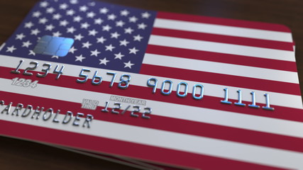 Plastic bank card featuring flag of the United States. National banking system related 3D rendering
