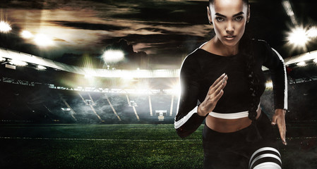 A strong athletic, women sprinter, running on staidum wearing in the sportswear, fitness and sport motivation. Runner concept with copy space.