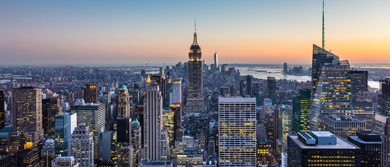 New York City. Manhattan downtown skyline with illuminated Empire State Building and skyscrapers at dusk. USA.