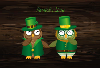 Happy owls in national costume at Patrick's Day. Greeting dard