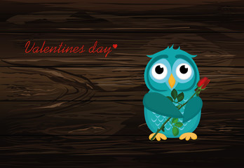 Cute blue owlet waiting to give a  of flower pink rose and heart