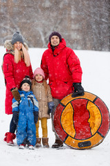 Photo of family with children, tubing