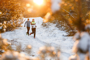 Image of running sports women and men in winter park
