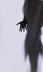 silhouette shadow of a girl hand on a white background