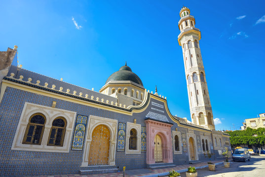 Minaret tower of mosque in old town Nabeul. Tunisia, North Africa