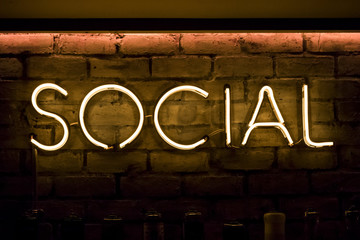 Social sign in neon yellow lights