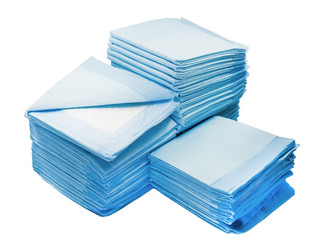 piles of toilet pads for pets isolated on white. home leak proog training pads for animals