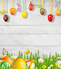 Idyllic spring meadow with Easter eggs and butterflies