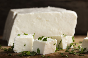 Close up of pieces of cheese with parsley leaves