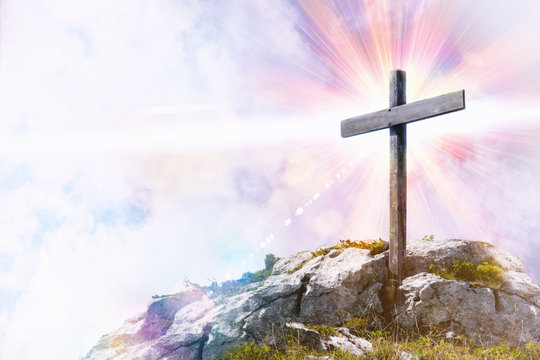 Religious representation with cross on top of a hill