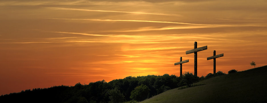 Religious representation with three crosses and nature landscape background