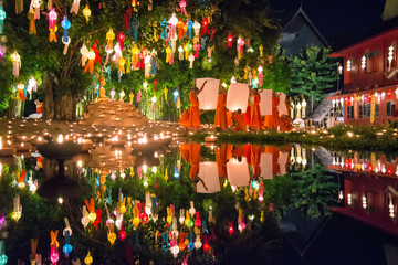 Buddhist monk floating hot air lantern in Yipeng festival at Loy krathong Day