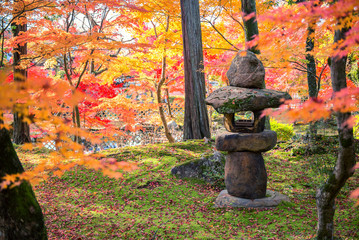 A Stone Lantern And The Japanese Garden With Maple tree in autumn season