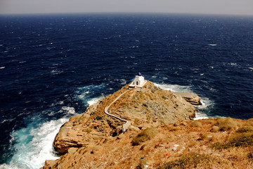 Landscape of Sifnos island, Greece, with the church of Seven Martyrs in the background.
