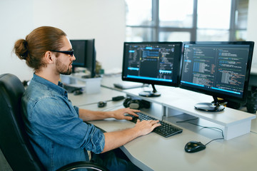 Programming. Man Working On Computer In IT Office