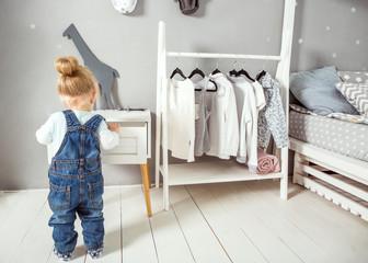 little girl  in your floor in her room