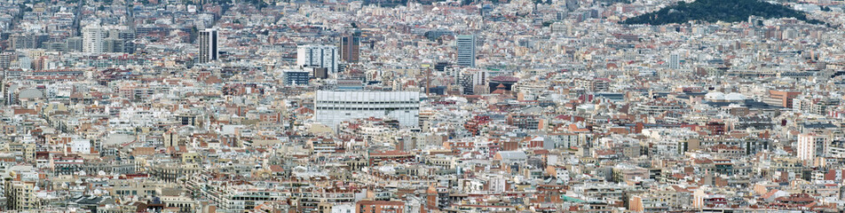 panorama aerial cityscape view of barcelona showing the dense crowded modern urban environment with housing and modern business developments