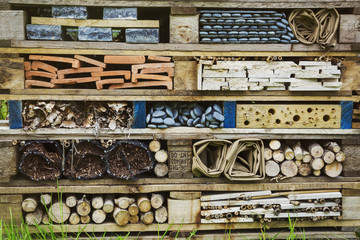 Close up of large bug house with several layers of different materials.