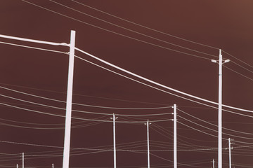 Abstract of power lines and telephone poles.