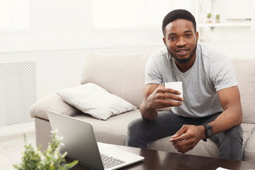 Young man at home drinking coffee