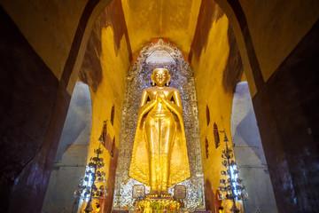 standing buddha in ananda temple, myanmar