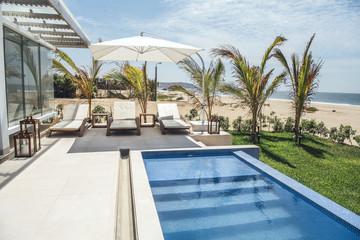 Pool and loungers at villa