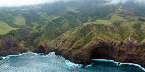 Aerial view of Maui's rocky coastline, shot from a small, low-flying prop plane