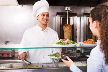 Male worker serving customer