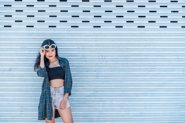 Portrait of beautiful asian woman,Hipsters girl for take a picture outdoor,Thailand people stand on stair