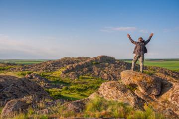 Happy hiker on mountain peak