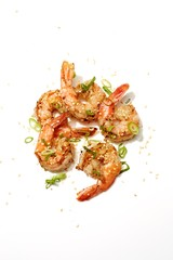 Grilled seasoned shrimp on white background