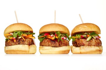Three hamburgers on white background