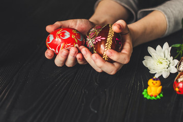 Easter eggs and marzipan figurines (traditional decoration). Copy space.