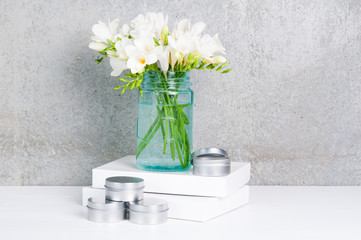desk top,feminine,flowers,spring,fresh,pretty,styled,tins,boxes,white,blue,grey
