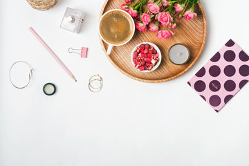 Feminine accessories, coffee and roses on the white background