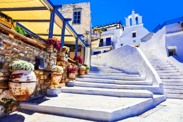 Traditional Greece - charming floral streets with tavernas, Naxos island, Cyclades